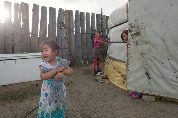 Ulaanbaatar, Mongolia, 09/28/2015. Three of Nyamsuren's daughters play outside her ger. Nyamsuren, 37,  lives with her husband and her 5 children aged 10, 8, 5, 3 and 1. Khaan-Uul district, Ulaanbaatar, Mongolia on 09/28/2015.